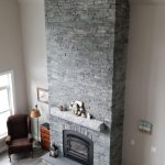 A look at the fireplace from the loft